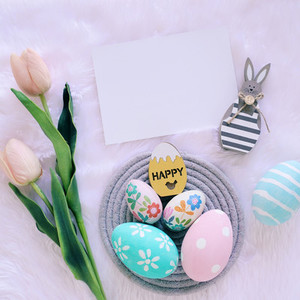 Happy Easter concept with wooden bunny and colorful easter eggs