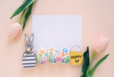 Happy Easter concept with blank card wooden bunny colorful eas