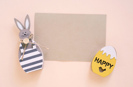 Happy Easter concept with blank card  wooden bunny and colorful
