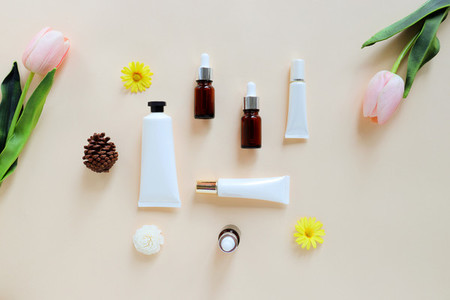 Flat lay of various organic skincare and beauty products for moc