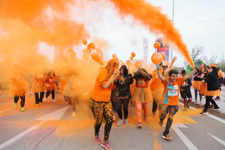 March 31  2019   Madrid  Spain   Aliexpress  celebrating its 9th anniversary with a colorful holi run in Valdebebas  Madrid  Spain