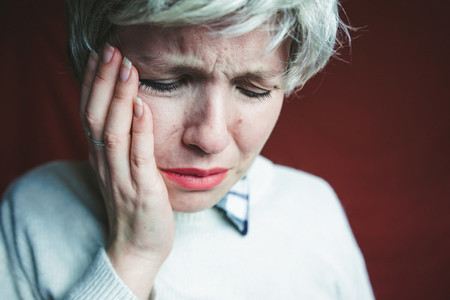 Middle age woman suffering pain