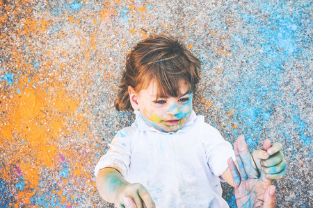 Little girl dirty of paint