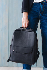Fashionable woman hold black bag