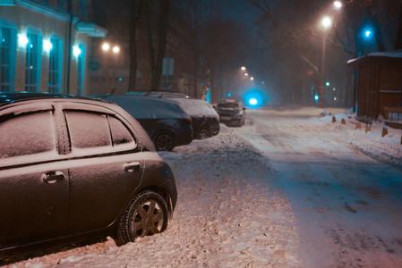 Snow covered night street