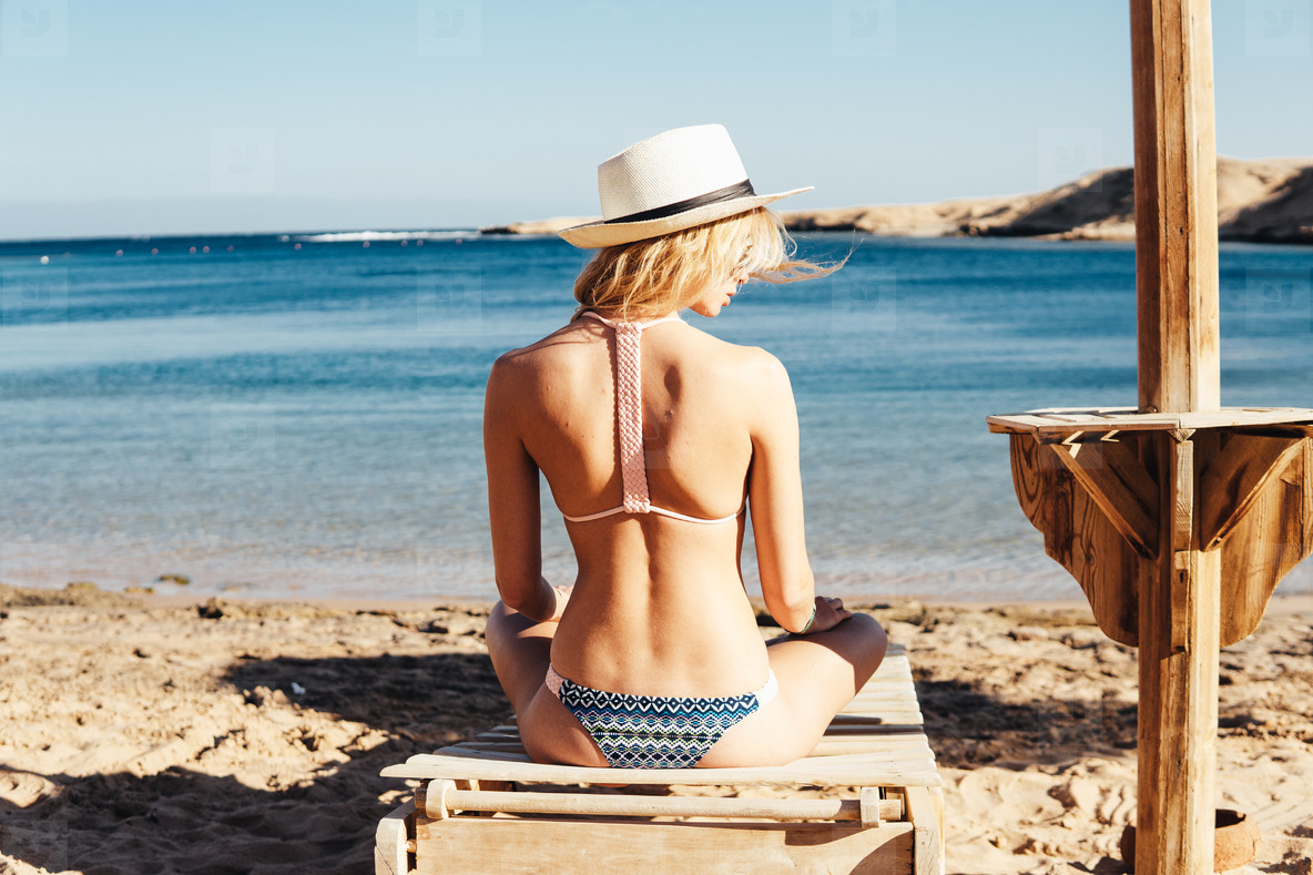 Young slim woman on beach