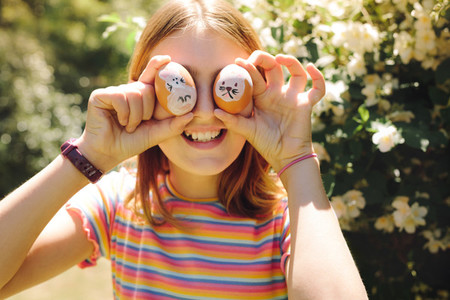 Close up of a girl holding easter eggs