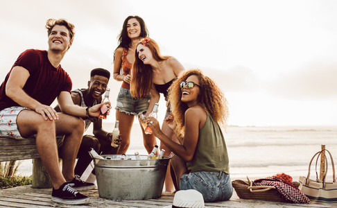 Multiracial friends hanging out at the beach
