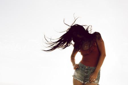 Carefree woman dancing outdoors