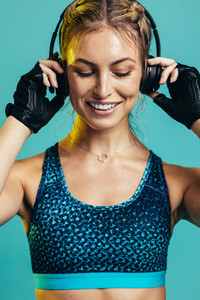 Sportswoman listening to music