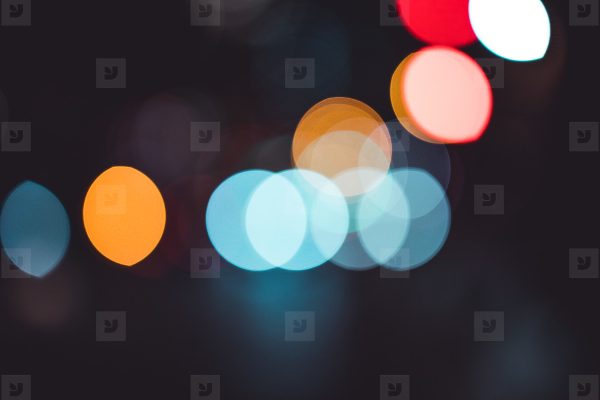 Abstract bokeh lights in city blurred night background