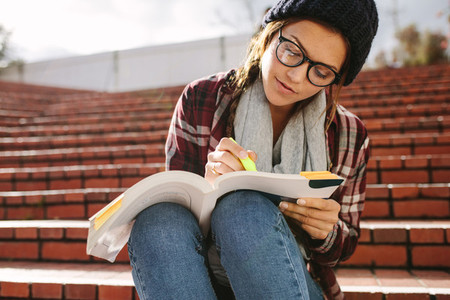 Woman studying at university campus