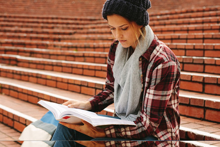 Female teenager studying in campus