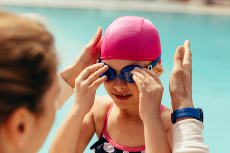 Girl getting ready for her swimming class