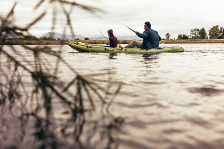 Father and son out for fishing in a kayak