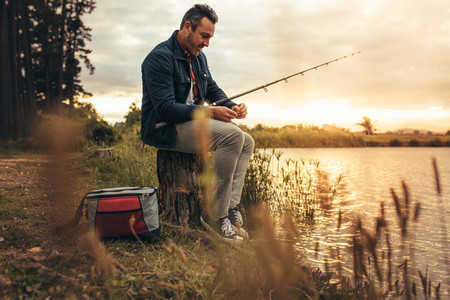 Man enjoying fishing near a lake