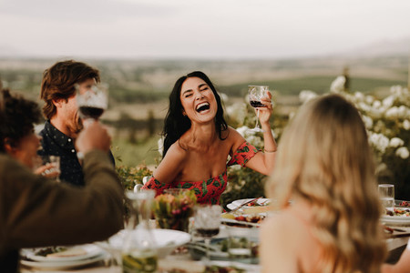 Group of people having great time at dinner party