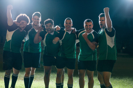 Professional rugby players celebrates a victory