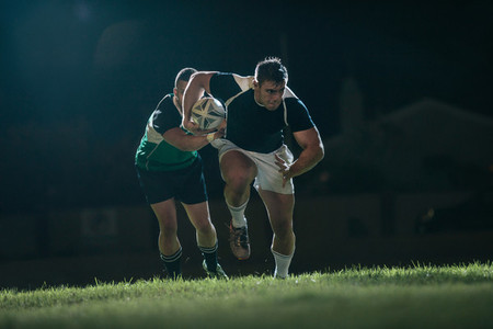Rugby player running with ball for making score