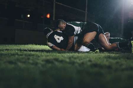 Rugby players fight for the ball