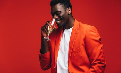 Stylish man having a glass of champagne