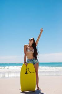 Woman surfer enjoying bodyboarding