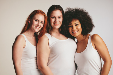 Group of different size women in white tank top