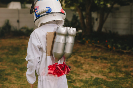Boy dressed as astronaut with a toy jetpack