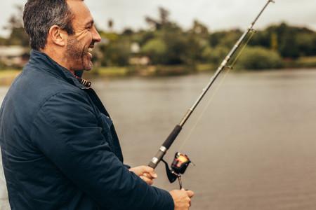 Happy man fishing in a lake