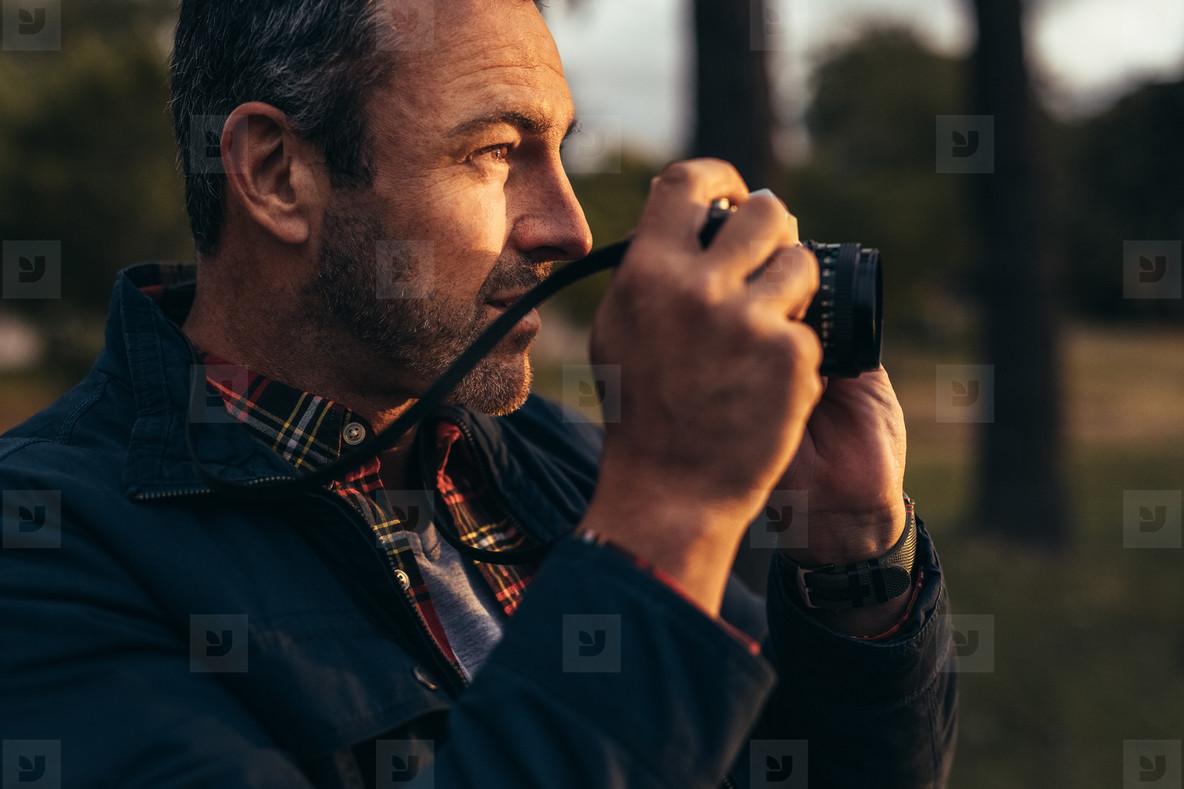 Tourist taking photos standing outdoors