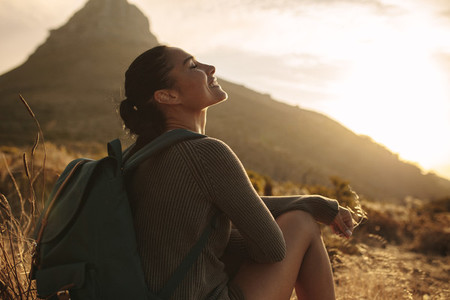 Woman resting after hiking on country trail