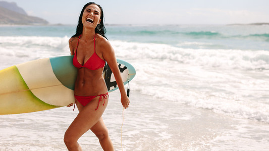 Woman on holiday enjoying surfing