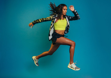 Fitness woman doing running exercise