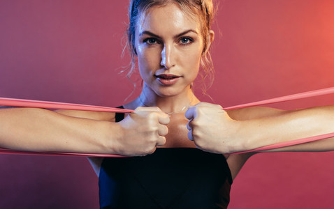 Tough woman exercising with resistance bands