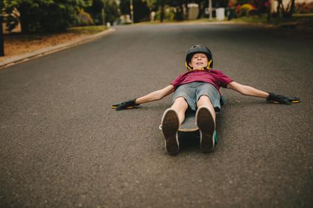 Playful boy skateboarding