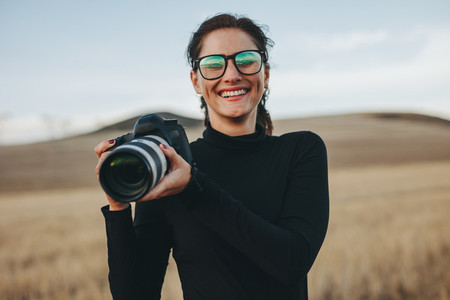 Photographer enjoying photo shooting outdoors