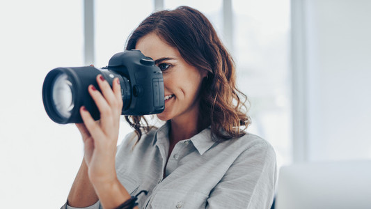 Woman photographing with dslr camera