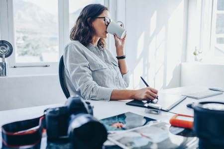 Woman editing images in office