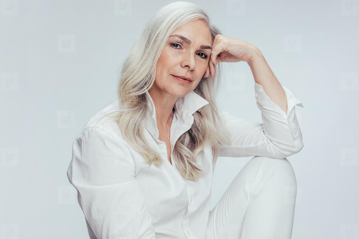 1399b025d67d Photos - Senior woman over white background - YouWorkForThem
