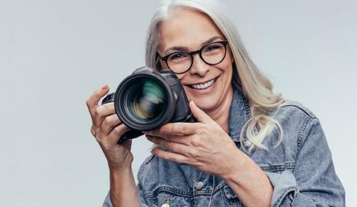 Senior photographer with a DSLR camera