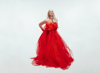 Beautiful senior woman in a red evening gown