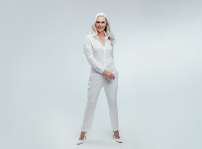 Beautiful Senior woman in white casuals