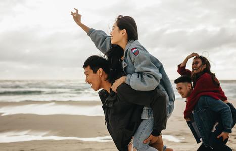 Cheerful friends enjoying on the beach