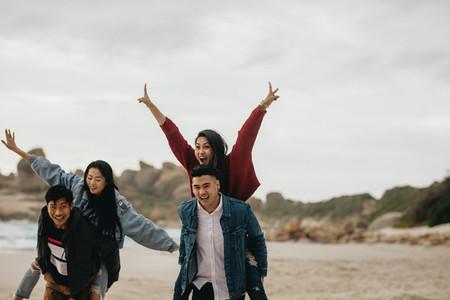 Friends having fun on beach vacation