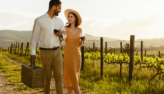 Couple on a day out walking in a vineyard