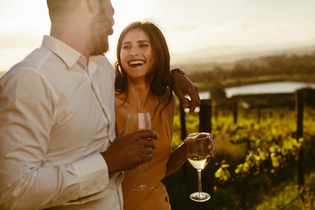 Couple on a romantic date in a vineyard
