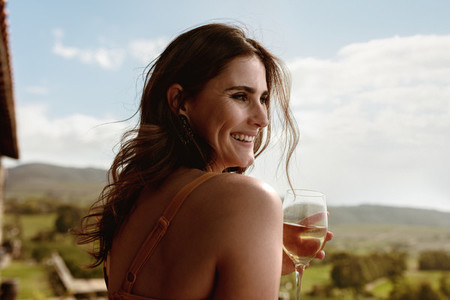 Close up of a woman drinking wine