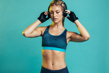 Muscular female with headphones