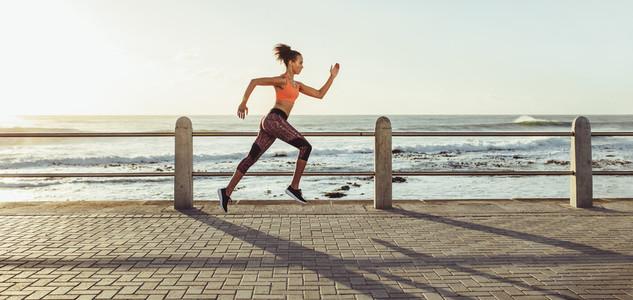 Woman sprinting on promenade