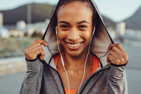 Confident fitness woman in a hoodie